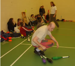Steve the Juggler does some Club Rolling at a workshop