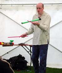 Steve the Juggler performing devilstick at Portsoy Boat Festival