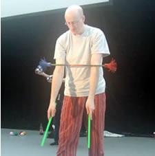 Steve the Juggler performing the arm roll devilstick trick